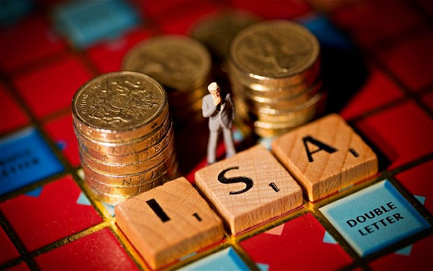 ISA spelled out on scrabble board alongside pound coins