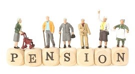 wooden blocks spelling out pension with elderly figures standing on the blocks