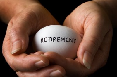 persons hands holding egg with retirement written on it