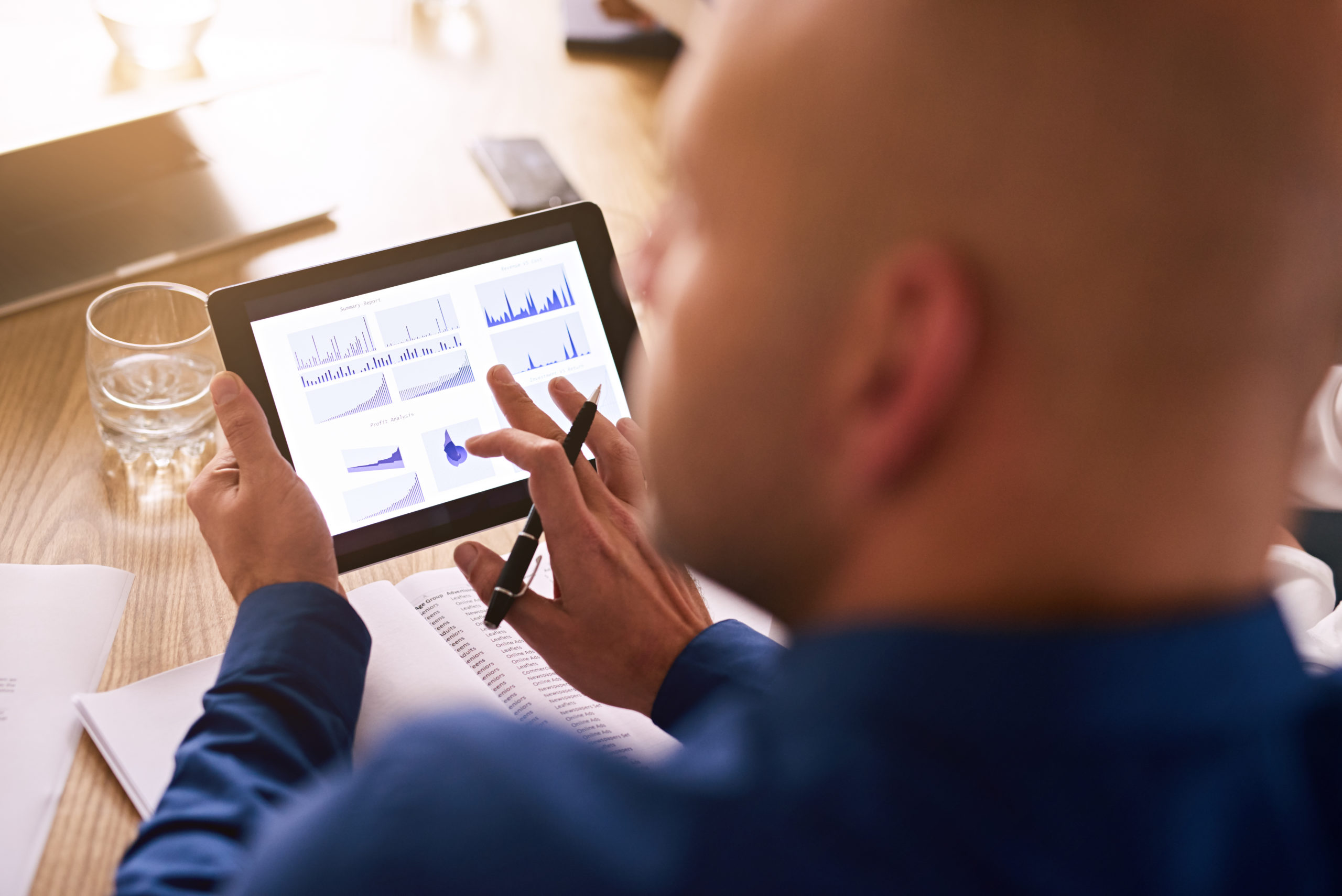 Man looking at investment on ipad